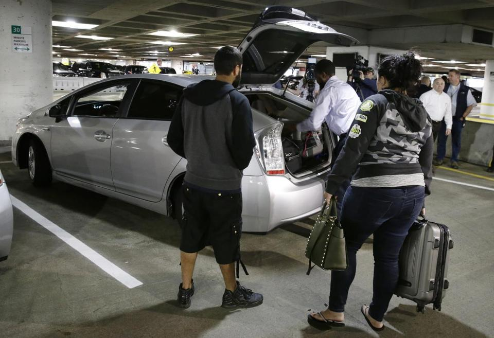 A driver for the Lyft ride-hailing service loaded luggage into his vehicle at Seattle-Tacoma International Airport.